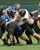 Aledo defensive players #20 Sam Forman and #43 DE Kyle Thompson stop the run by #21 North Forney RB #21 Ty Collins.