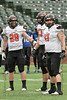 Aledo players #29 Caden Anderson, #43 Kyle Thompson, and #97 Matthew Bell look to the sideline for the next defensive play call.