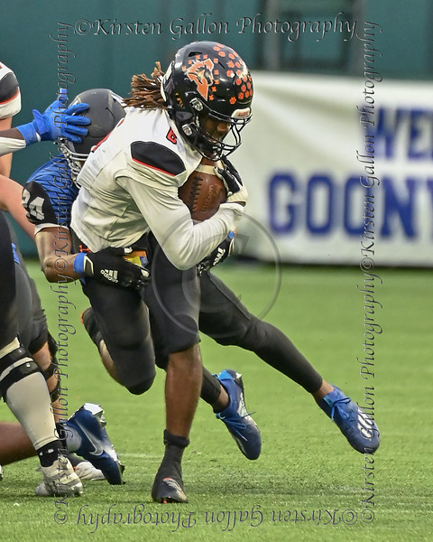 Aledo RB #6 DeMarco Roberts tries to break free from #24 North Forney SS Donovan Holt.