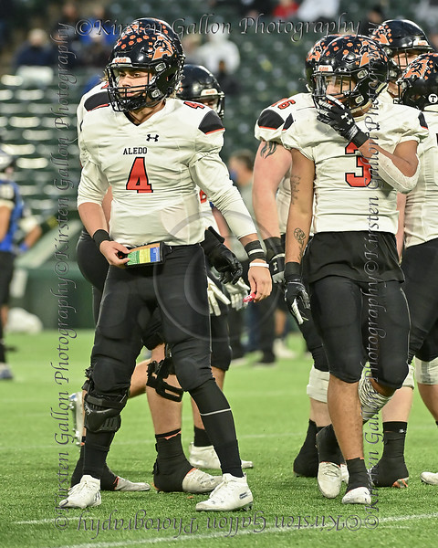 Aledo quarterback #4 Ethan McBrayer looks to the sideline for the next play call aalong with #3 RB Jeremiah James.