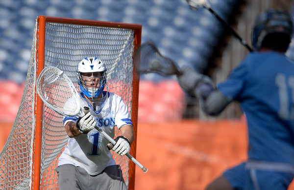 . Alexander Dawson goalkeeper Chad Dunnell waits to try to block the shot of an opponent during 4A State Championship lacrosse game against Valor Christian on Friday at Sports Authority Field in Denver. More photos: BoCoPreps.com Jeremy Papasso/ Staff Photographer May 20, 2016