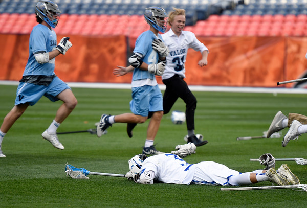 . Alexander Dawson\'s Jack Shams lays on the ground after losing the 4A State Championship lacrosse game against Valor Christian 10-9 on Friday at Sports Authority Field in Denver. More photos: BoCoPreps.com Jeremy Papasso/ Staff Photographer May 20, 2016