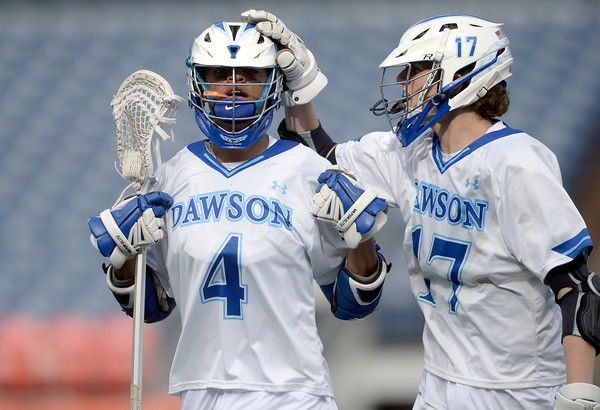 . Alexander Dawson\'s Wyatt Watts is congratulated on a goal by teammate Michael Fricke during 4A State Championship lacrosse game against Valor Christian on Friday at Sports Authority Field in Denver. More photos: BoCoPreps.com Jeremy Papasso/ Staff Photographer May 20, 2016
