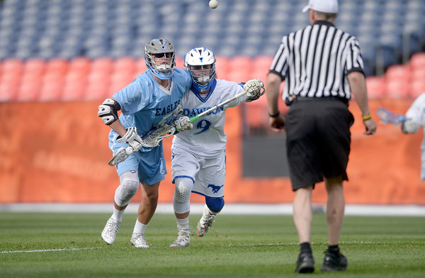 . Alexander Dawson\'s Kyle Sudol chases a ball with Eric Pacheco during 4A State Championship lacrosse game against Valor Christian on Friday at Sports Authority Field in Denver. More photos: BoCoPreps.com Jeremy Papasso/ Staff Photographer May 20, 2016