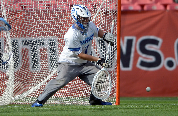 . Alexander Dawson goalkeeper Chad Dunnell makes a save during 4A State Championship lacrosse game against Valor Christian on Friday at Sports Authority Field in Denver. More photos: BoCoPreps.com Jeremy Papasso/ Staff Photographer May 20, 2016