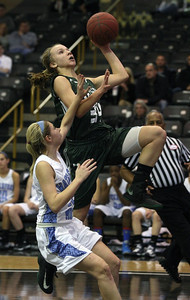 MottKettGhoop-3.02102014 Lauren Tewes (34), Waterford Kettering, goes up for a shot over Jaime Carter, Waterford Mott, during girls varsity basketball action at Oakland University Monday, Feb. 20, 2014. (Special to The Oakland Press / LARRY McKEE)