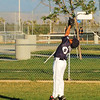 Victorville's Right Fielder stretches for fly ball