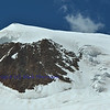 the broad ice capped summit of the  Alphubel in the southern swiss alps between Zermatt and Saas Fee showing the main route to the summit