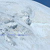 3 climbers roped together on a massive glacier on a high altitude mountain