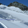 The summit of the Feechopf above the Fee glacier and crevasses in the southern swiss alps between Zermatt and Saas Fee.