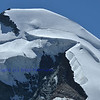 The high ice covered summit of the Allalinhorn in the southern swiss alps between Zermatt and Saas Fee in the Mischabel range