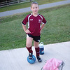 Posing before her first ever soccer game.  She scored a goal in a 6-6 tie.