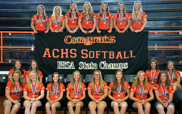 The Altamont High School girls softball team stands together during a team pep rally Sunday in the high school's gym.