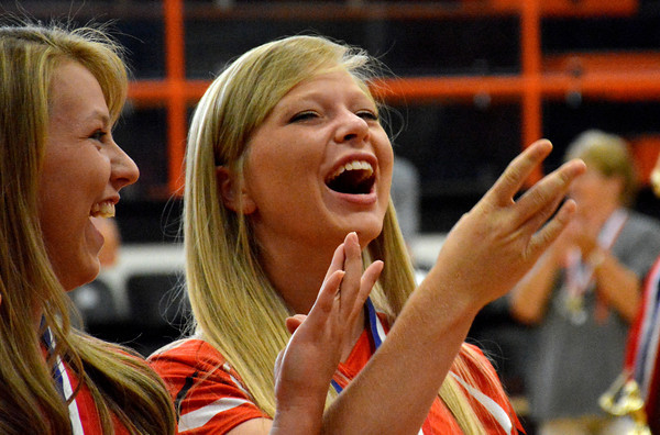 "Alex Teasley and Deidre Ledbetter laugh as ""We Are The Champions"" by Queen plays during a pep rally for the Altamont High School girls softball team Sunday in the high school's gym."