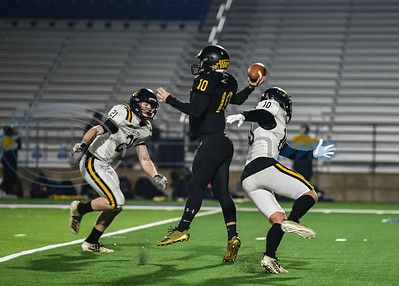 Cayuga quarterback Logan Vaughan (10) gets off a pass before being tackled in the first round of the playoffs against Alto. The teams met at the Tomato Bowl in Jacksonville on Thursday, November 14. (Jessica T. Payne/Tyler Morning Telegraph)