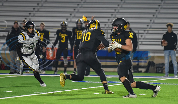 Cayuga quarterback Logan Vaughn (10) hands off to Casen Grasch (32) in a game against Alto on Thursday. The first-round playoff game was played at the Tomato Bowl in Jacksonville. (Jessica T. Payne/Tyler Morning Telegraph)