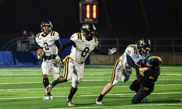 Alto running back Vidareous High (2) gets a block from Foster Hall (60) allowing him to run for a touchdown in the first-round playoff game against Cayuga on Thursday. (Jessica T. Payne/Tyler Morning Telegraph)