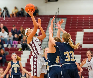 Olivia Hudson in the lane over 2 defenders #4 Lucy Race and #33 Olivia Gribble