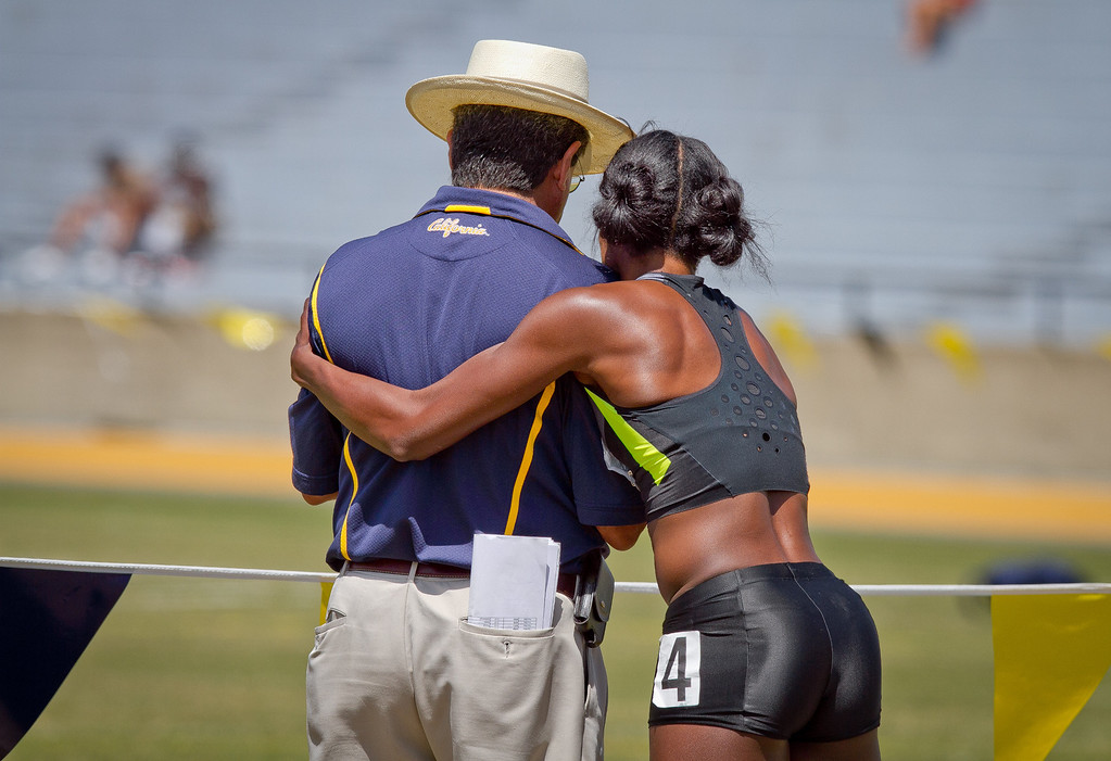 Alysia Montano hugs Cal track coach Tony Sandoval after running the Wonen's 400 meter in the Brutus Hamilton Invitational track meet at Edwards Stadium in Berkeley, Calif., on Saturday Aril 28th, 2012.