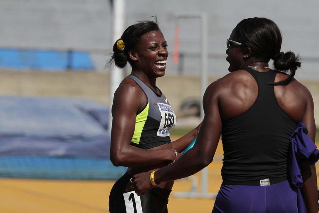 Alysia Montano has a laugh with another runner after she ran the Women's 4X400 meter relay in the Brutus Hamilton Invitational track meet at Edwards Stadium in Berkeley, Calif., on Saturday Aril 28th, 2012.