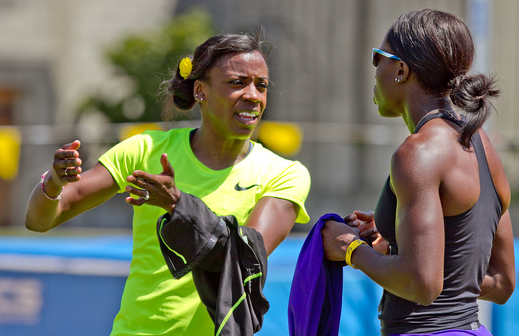 Alysia Montano talks with Ugo Eke after running  the Wonen's 400 meter in the Brutus Hamilton Invitational track meet at Edwards Stadium in Berkeley, Calif., on Saturday Aril 28th, 2012.
