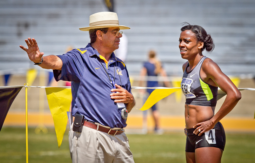 Alysia Montano talks with Cal track coach Tony Sandoval after running the Wonen's 400 meter in the Brutus Hamilton Invitational track meet at Edwards Stadium in Berkeley, Calif., on Saturday Aril 28th, 2012.