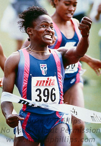 Mary Mutola, a high school student from Mozambique, celebrates as she hits the tape to win the women's 800-meter run during the New York Games at Columbia University on July 20, 1991.