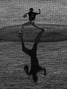 Dominic Rutigliano of the Brockton Rox casts a large shadow as he pitches against the Worcester Bravehearts at Hanover Insurance Park at Fitto in Worcester, MA.