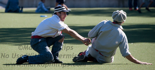 Gabriel Rosenberg moves to tag out a stealing player during New York Gothams game at Washington Park on Third Avenue in Park Slope