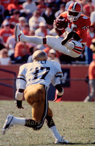 Clemson University's Ray Williams catches a pass over Georgia Tech's Sammy Lilly during game at Clemson's Death Valley on Sept. 28, 1985.