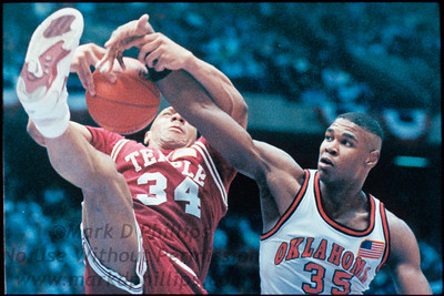 James Spears of Temple fights to keep the ball from Oklahoma's Byron Houston during their 72-63 loss on March 22, 1991, at Brendan Byrne Arena in East Rutherford, New Jersey, at the NCAA East - Regional Semifinal.