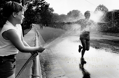 Runner sprayed by child with hose during race in Morganton, NC / First picture to ever win major award for me at Southern Short Course in News Photography