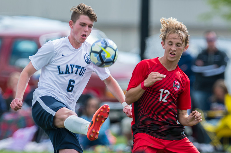 Christian Logan (6) clears out the ball before American Fork defender Aaron Jolley (12) could get possession at Layton High school on May 19, 2017.