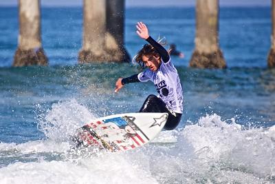 Pro surfer Aryn Farris shredding a small wave.