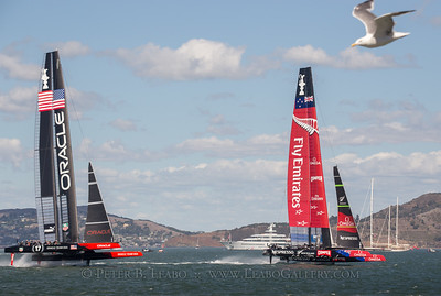 Emirates New Zealand takes the lead against Oracle Team USA after rounding the first mark in the final race of the 34th Americas Cup on San Francisco Bay