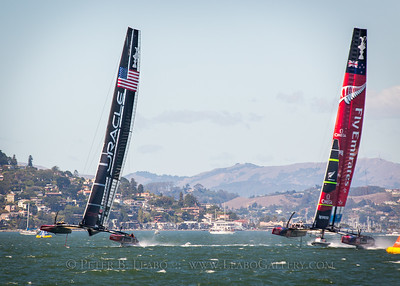 Oracle Team USA takes a slight lead against Emirates New Zealand as they cross the start line on San Francisco Bay for the final race of the 34th Americas Cup