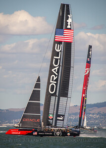 Oracle Team USA takes the lead against Emirates New Zealand on the third leg of the final race of the 34th Americas Cup on San Francisco Bay