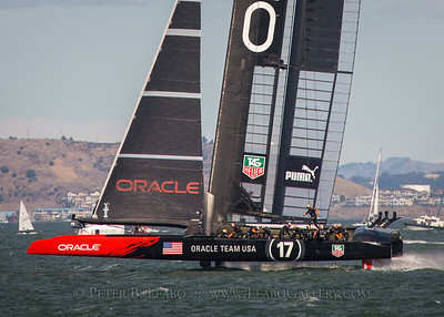 Oracle Team USA rides on foils on an upwind tack as it leads Emirates New Zealand in the final race of the 34th Americas Cup on San Francisco Bay