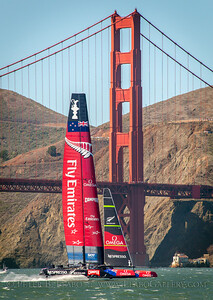 Emirates New Zealand heads for the fourth mark as the Golden Gate Bridge towers in the background in the final race of the 34th Americas Cup on San Francisco Bay