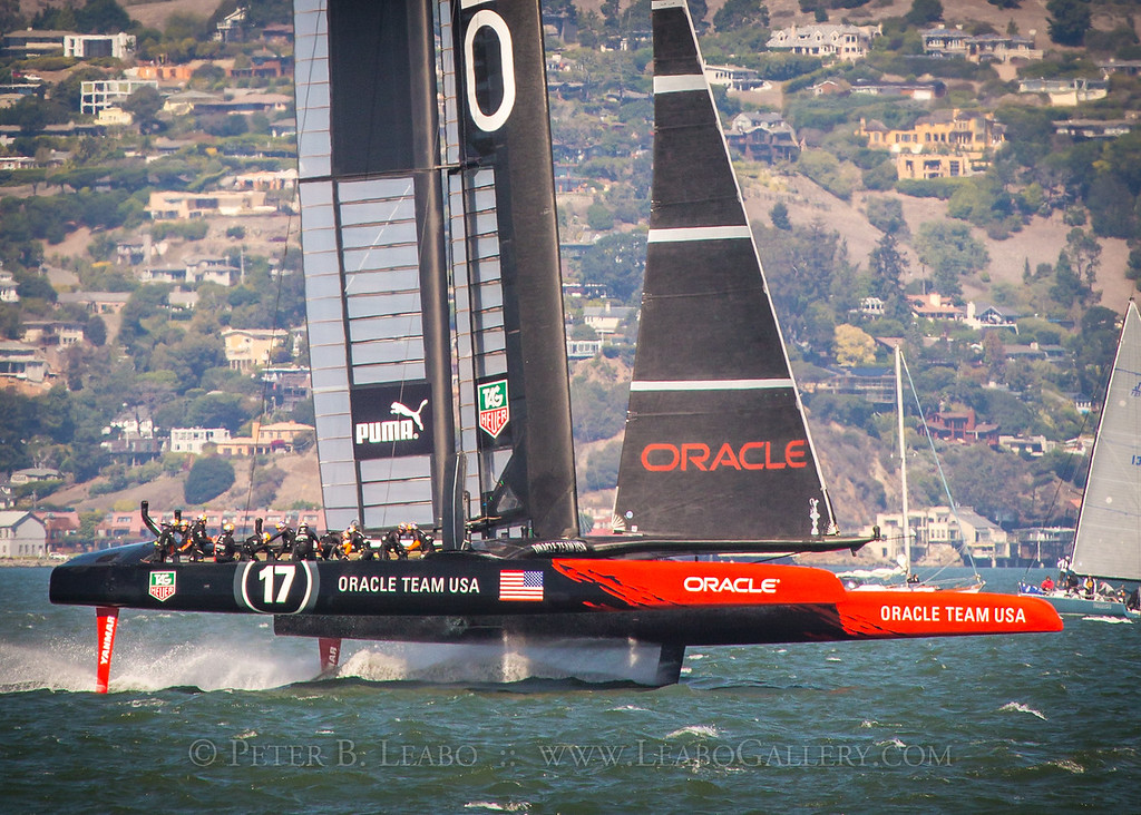 Oracle Team USA rides on foils on a downwind tack as it leads Emirates New Zealand in the final race of the 34th Americas Cup on San Francisco Bay