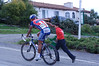 Christopher Stockburger being cheered on by a young fan on the way up Sierra Road in San Jose.