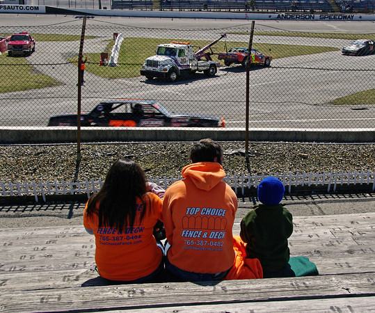 Kristen, Matt and Colton Vanalst watch Thunder Car practice during opening day activities at Anderson Speedway. Matt is the brother of CRA Late Model Sportsman Series driver Greg Vanalst of Dalville.