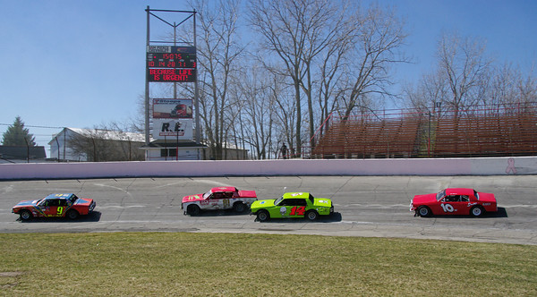 Thunder Cars practice on the high banks of Anderson Speedway during opening day activities.