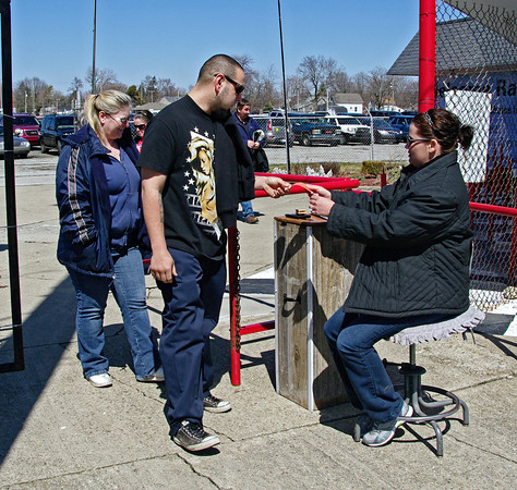 Lauren Dawson takes tickets from race fans Justin Banuelos and Michelle Pattison on opening day at Anderson Speedway.