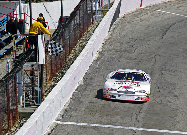 Jason Atkinson takes the checkered flag from Gary Mong after winning the pole by setting a new track record for the Vores Welding CRA Late Model Sportsman Series Powered by JEGS during opening day racing at Anderson Speedway.