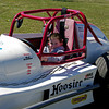 Young race fan Chase Waters of Danville, Indiana tries out the seat of a Thunder Roadster on opening day at Anderson Speedway.