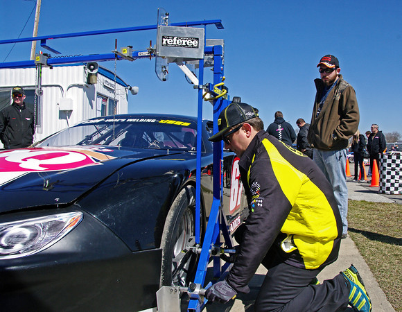 CRA Tech inspector Trevor Fallis checks to see that a Late Model Sportsman is complies with the rules prior to practice on the opening day at Anderson Speedway.