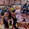 MARY SCHWALM/Staff photo Central Catholic's Courtney Walsh drives into Andover defender Rebecca Alois on her way to the basket during their basketball game in Lawrence.  1/9/14