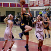 MARY SCHWALM/Staff photo Andover's Colleen Caveney drives to the basket between Central Catholic defenders Courtney Walsh, left, and Caitlin Dell'Orfano  during their basketball game in Lawrence.  1/9/14