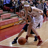 MARY SCHWALM/Staff photo Andover's Colleen Caveney and Central Catholic's Amanda Williams pull up for grabbing a loose ball out of bounds during their basketball game in Lawrence.  1/9/14